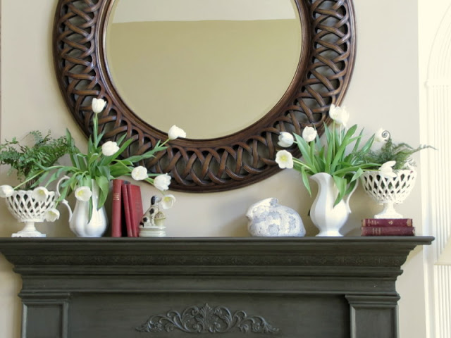 spring mantel design with circle mirror, white tulips and bunnies
