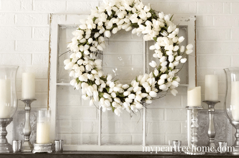 lovely white-themed spring fireplace mantel decor with white tulip wreath