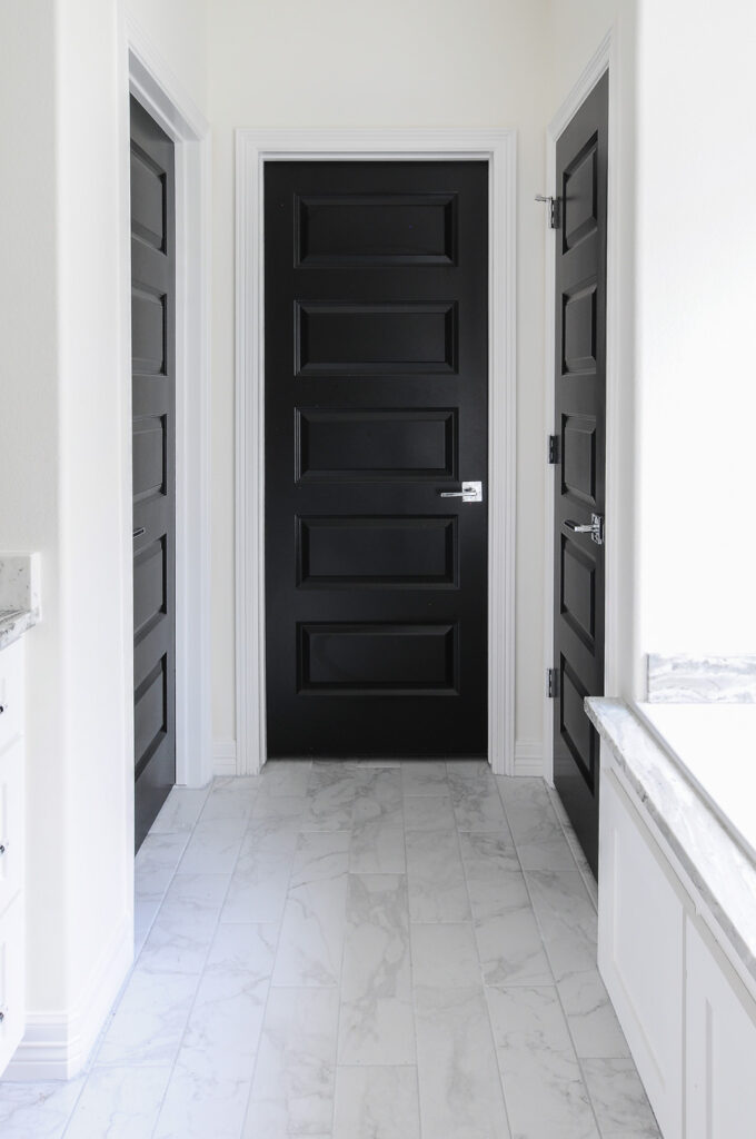 hallway with white walls and black interior door paint color