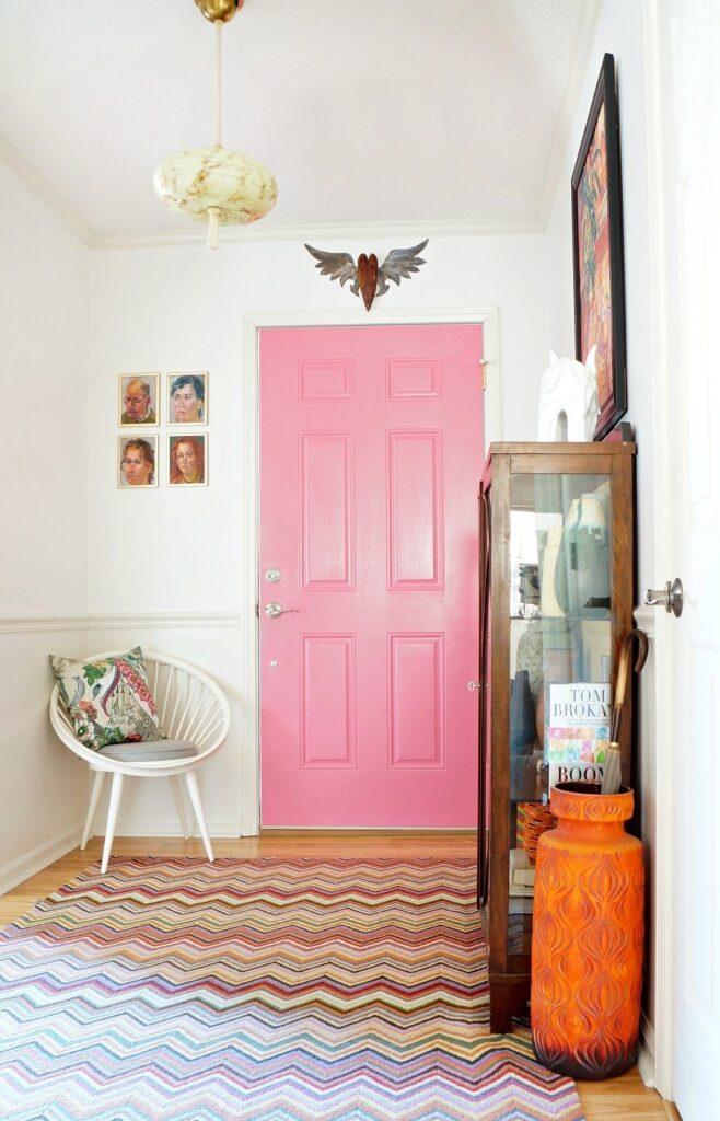 boho pink interior door in an entryway