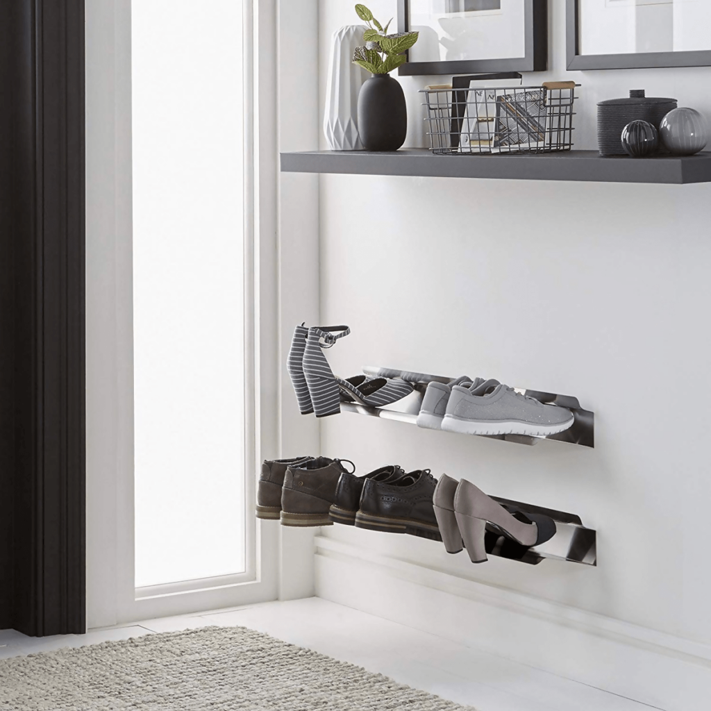 Wall-mounted shoe rack keeps this entryway clean and organized.