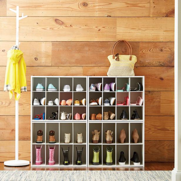Stackable shoe organizer holds a dozen pairs of shoes.