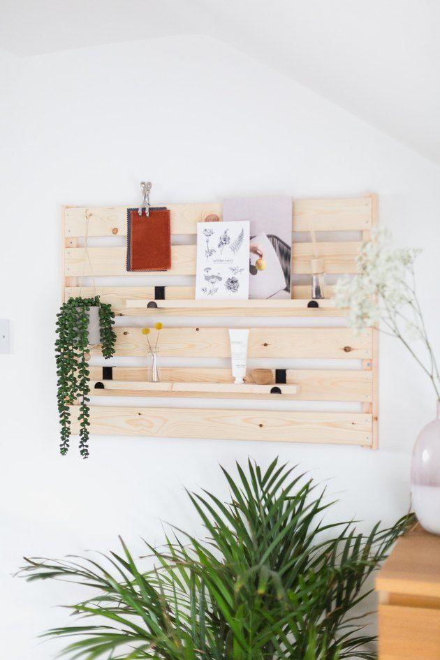 IKEA hack: mount a shelf sideways on a wall for minimalist entryway storage and styling.