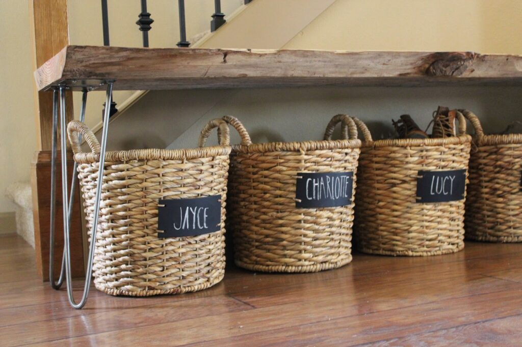 Small entryway storage ideas: labeled baskets tucked away underneath a bench keeps personal belongings organized and out of sight.