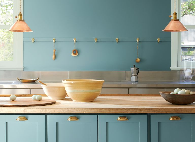 Benjamin Moore's Color of the Year for 2021, Aegean Teal painted on a kitchen wall and cabinets.