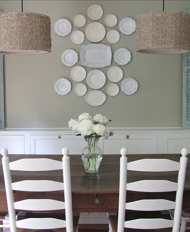 Gray Mirage by Benjamin Moore is actually a sage green paint color, as shown in this country-chic dining room.