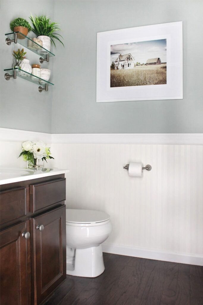 Sherwin Williams Oyster Bay is a pretty light-to-medium green paint shade. It looks great in this powder room, paired with white bead board.