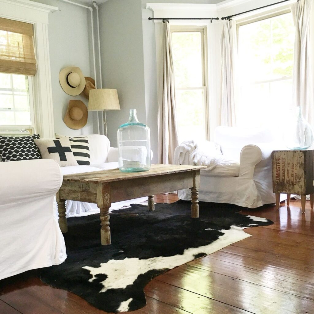 Light green paint colors like Healing Aloe look beautiful with rustic decor and neutral palettes.