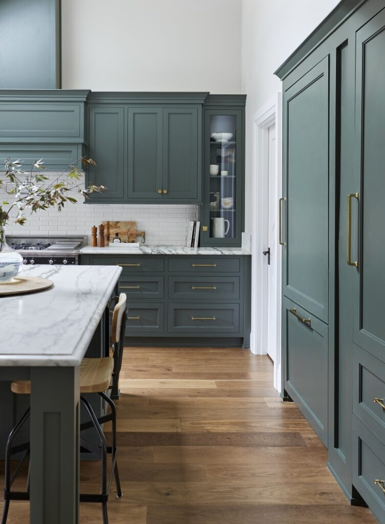 Kitchen cabinets in Pewter Green by Sherwin Williams, paired with gold cabinet hardware.