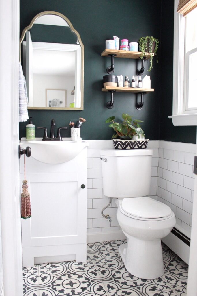 Powder room with white subway tile and upper walls painted Salamander by Benjamin Moore.