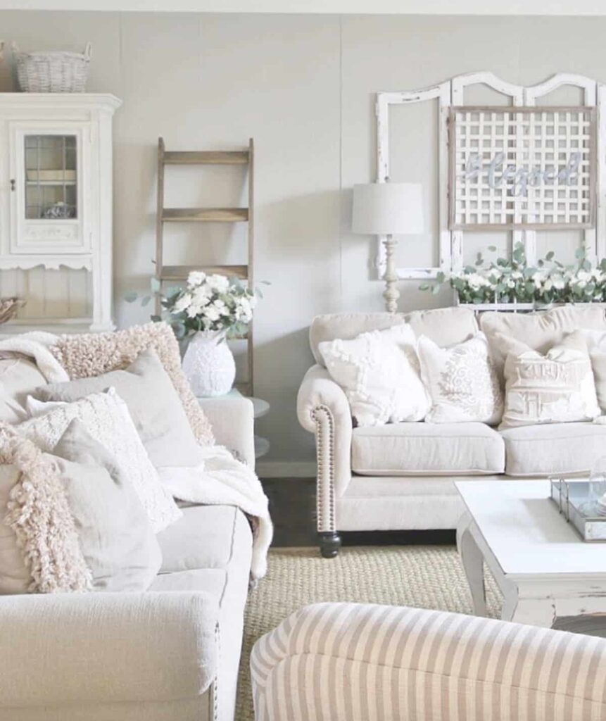 Bright shabby chic-inspired living room with off-white color palette and Mindful Gray walls.
