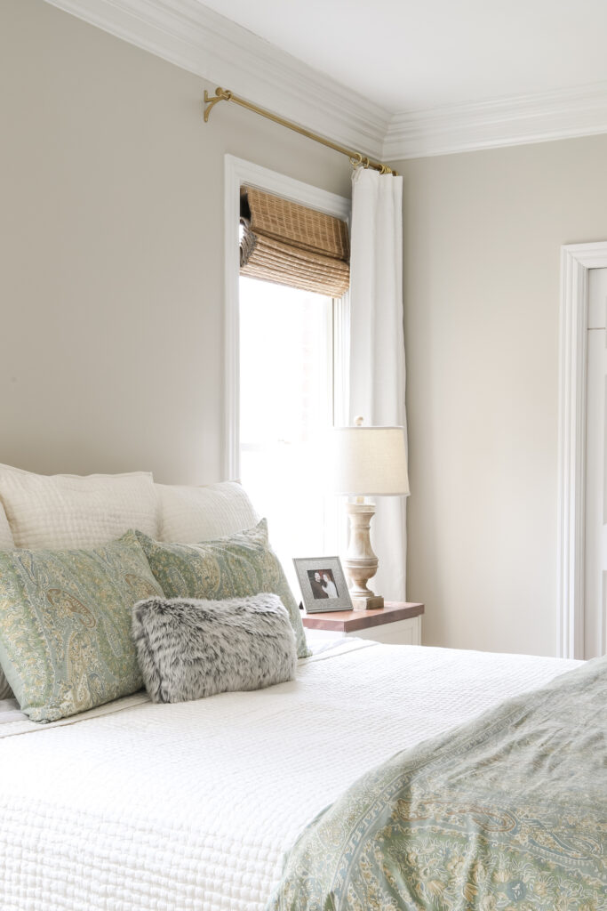 Bamboo Shades and Ivory Curtains in the Master Bedroom