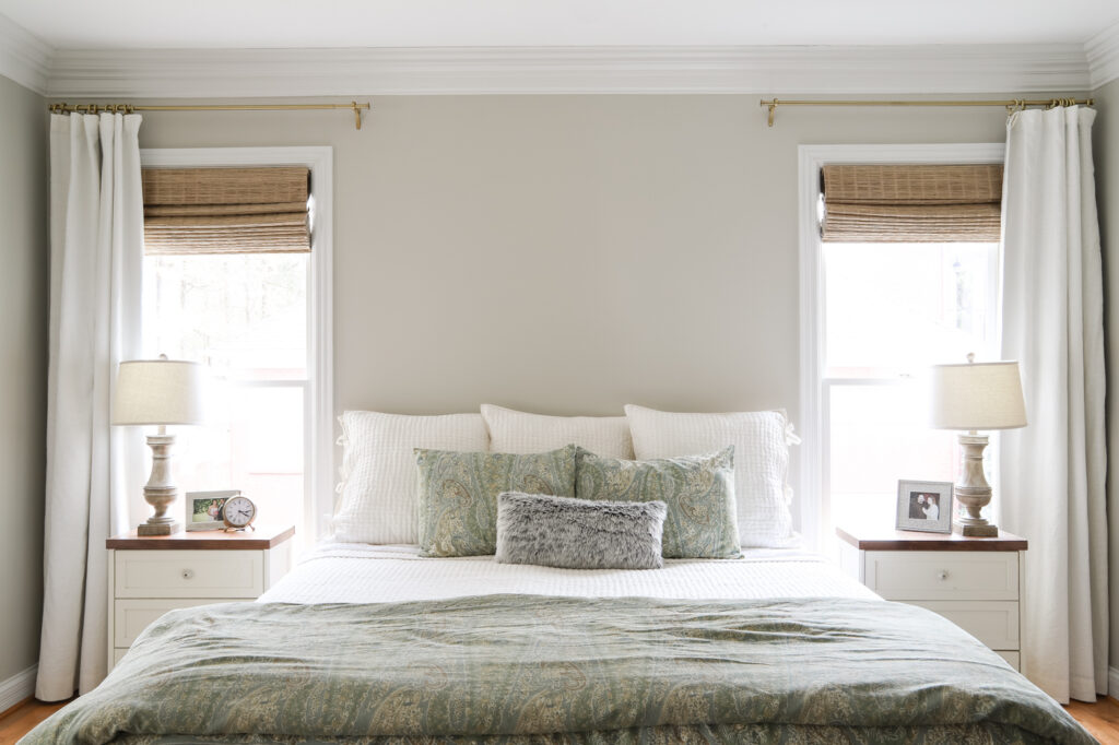 King size bed with bamboo shades and curtains