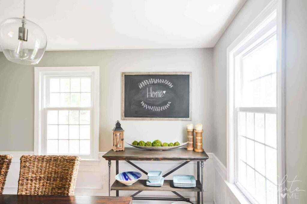 Bright dining room with neutral decor accents and walls painted Mindful Gray.