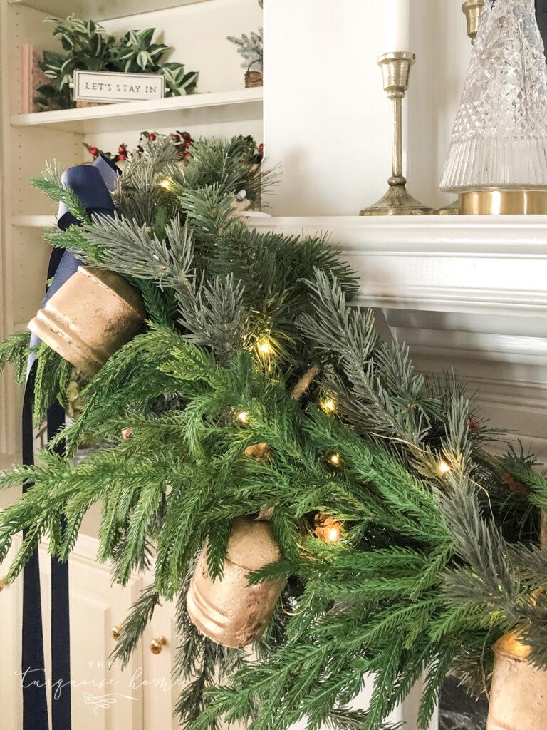 Brass iron bells hanging on a Christmas mantel