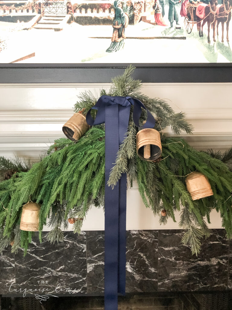 navy bow and brass bells in Christmas garland