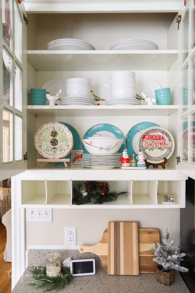 Christmas Plates behind a Glass Cabinet Door