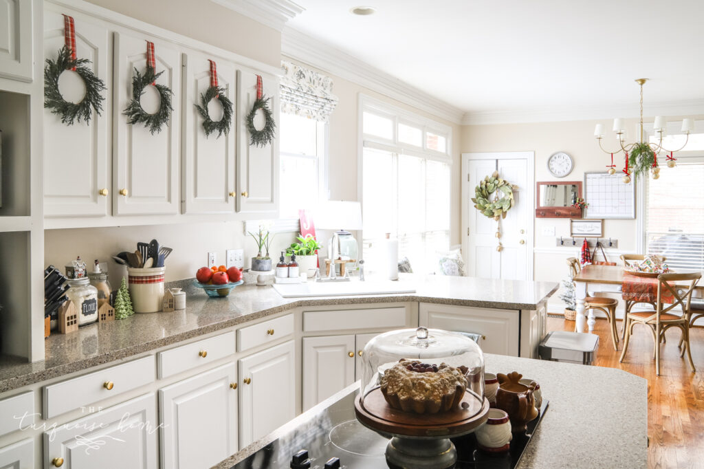 Christmas Wreaths on White Kitchen Cabinets