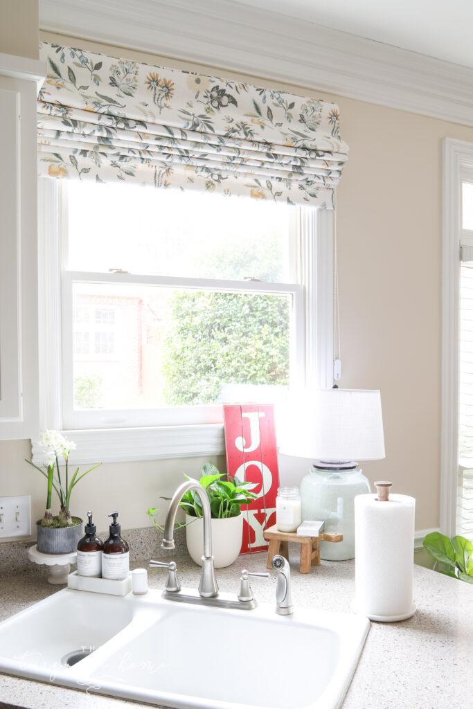 Roman shade on window
