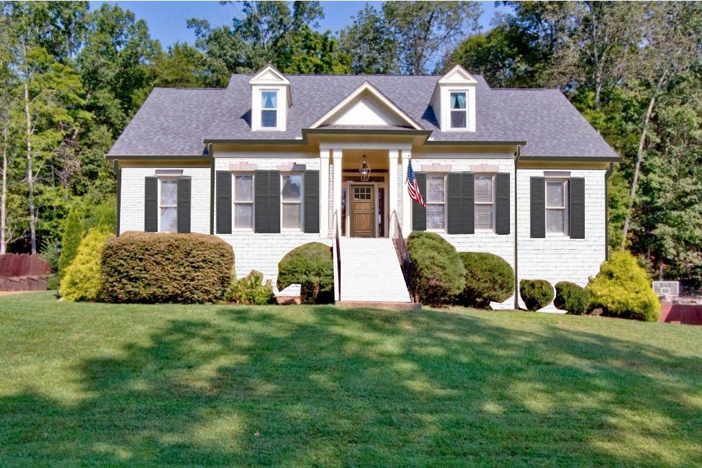 White brick cape cod style home