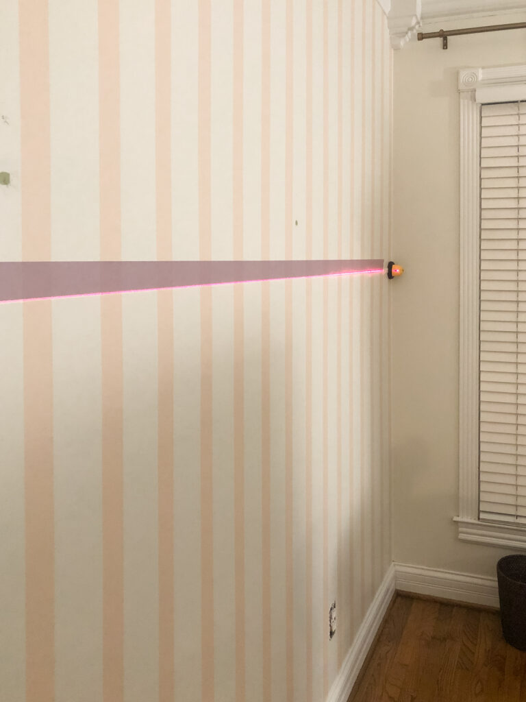 Laser level on striped wall