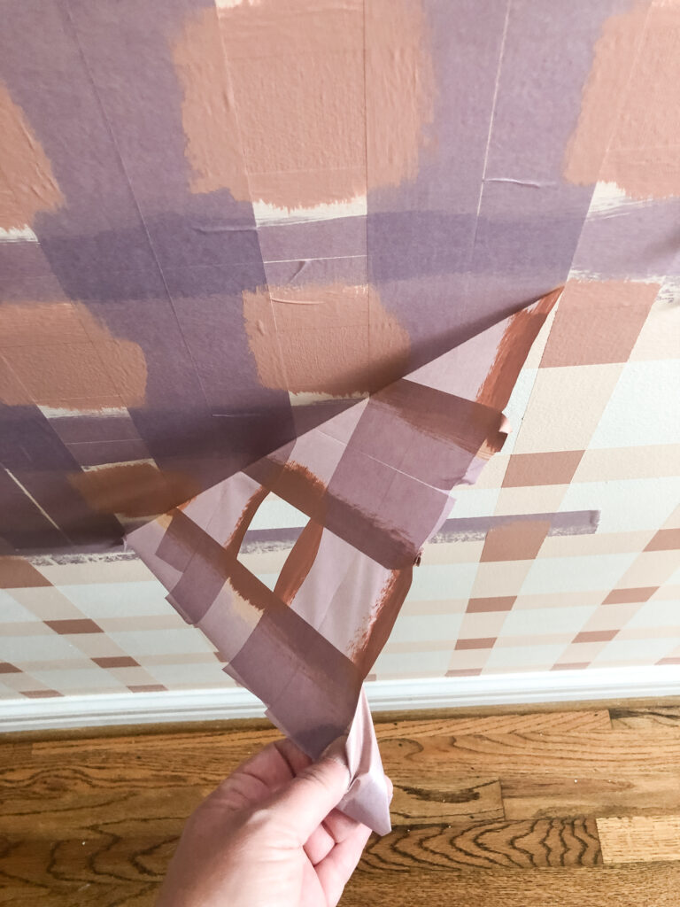 Remove tape on painted plaid wall