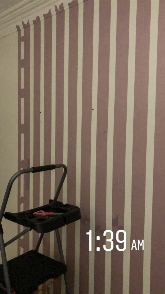 Tape lines for plaid painted wall