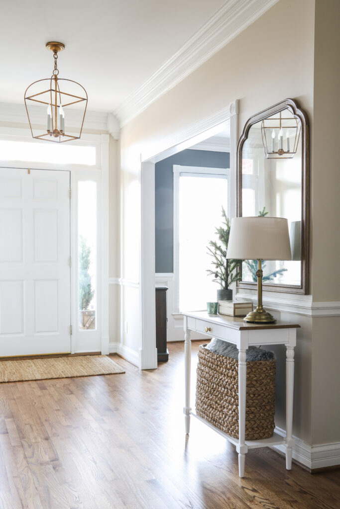 An Organized Foyer with table, lamp and mirror!