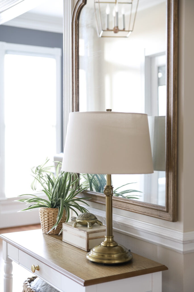 Table Lamp & Mirror in the Foyer