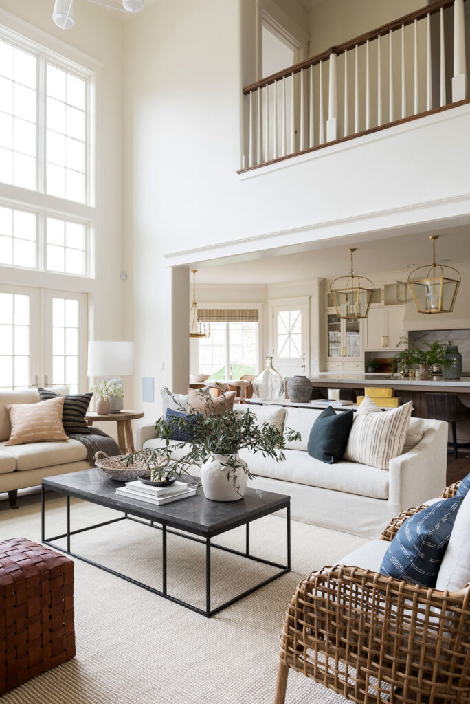 large airy living room painted in Swiss Coffee by Benjamin Moore