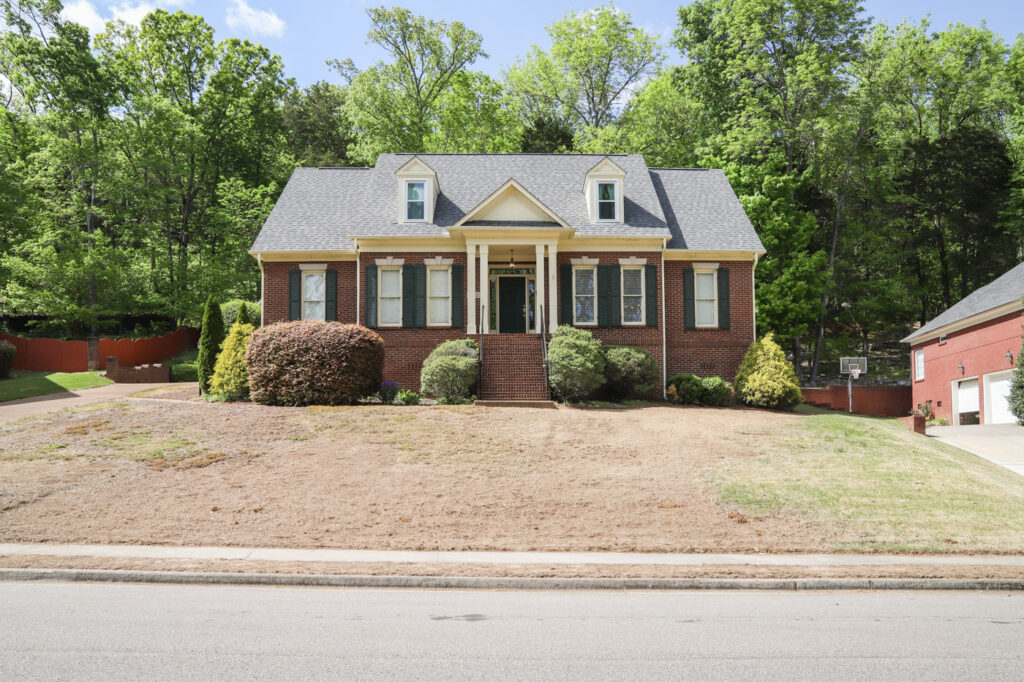 Exterior Brick Home in need of sod