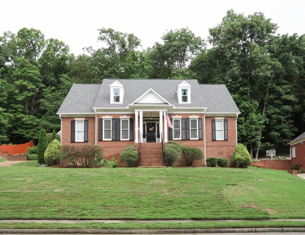 Brick Home Exterior Makeover (white trim and black shutters)