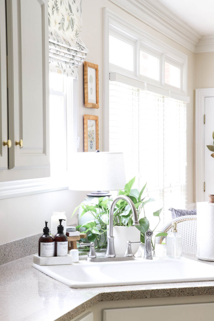 White Sink, Marble Soap Tray and Lamp Behind Sink
